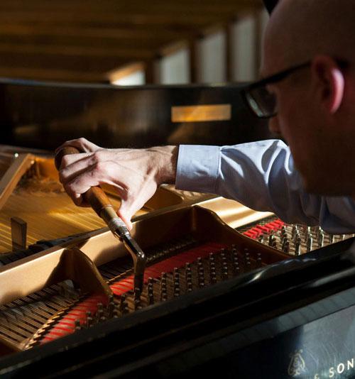 John tuning a piano